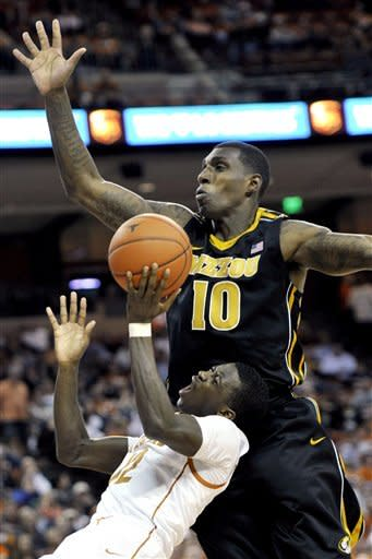 Missouri forward Ricardo Ratliffe (10) defends a shot from Texas guard Myck Kabongo during the second half of an NCAA college basketball game, Monday, Jan. 30, 2012, in Austin, Texas. Missouri won 67-66. (AP Photo/Michael Thomas)