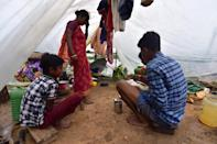 NAGAON,INDIA-JULY 22,2020 :Villagers take shelter on a makeshift camp at a flood-affected village in Nagaon district of Assam ,India - PHOTOGRAPH BY Anuwar Ali Hazarika / Barcroft Studios / Future Publishing (Photo credit should read Anuwar Ali Hazarika/Barcroft Media via Getty Images)