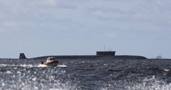 FILE In this Thursday, July 2, 2009 file photo a new Russian nuclear submarine, Yuri Dolgoruky, is seen during sea trials near Arkhangelsk, Russia. The submarine was commissioned by the Russian Navy on Thursday, Jan. 10, 2013. (AP Photo/Alexander Zemlianichenko, pool, file)