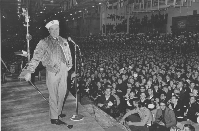 "FILE - Comedian Bob Hope entertains sailors of the U.S. 6th Fleet Saratoga at the flagship's anchorage in the southern Italian port of Gaeta, in this Dec. 19, 1970 file photo. Hope is on his annual United Service Organizations (USO) tour to entertain Americans serving overseas. Hope, beloved actor and comedian, who died 10 years ago at age 100, is being celebrated at the National World War II Museum in New Orleans, where the World Golf Hall of Fame & Museum has brought the ""Bob Hope: An American Treasure"" traveling exhibition. The exhibit officially opens Saturday Aug. 3, 2013. (AP Photo, File)"