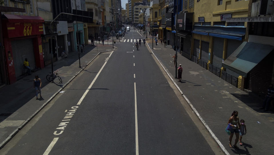 Picture of an almost empty street in Sao Paulo, Brazil, taken on March 15, 2021 hours before a night-time curfew takes effect in the state of Sao Paulo amid the novel coronavirus COVID-19 pandemic. - The state of Sao Paulo has been in a