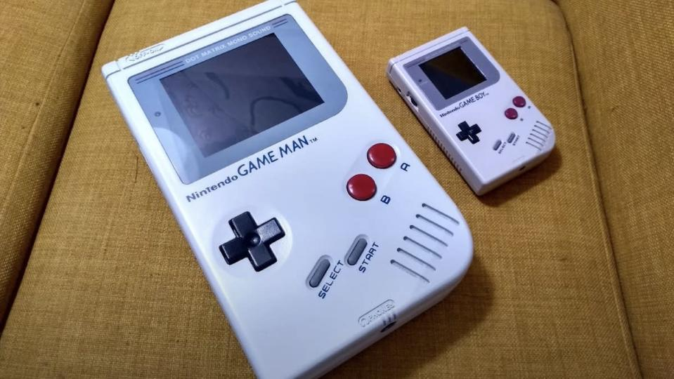 A giant fan-made version of the Nintendo Game Boy resting next to an original version
