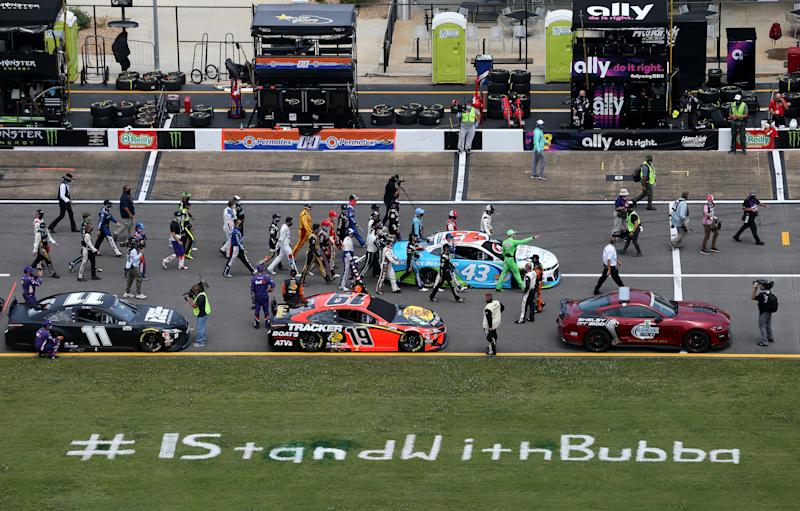 TALLADEGA, ALABAMA - JUNE 22: NASCAR drivers push the #43 Victory Junction Chevrolet, driven by Bubba Wallace, to the front of the grid as a sign of solidarity with the driver prior to the NASCAR Cup Series GEICO 500 at Talladega Superspeedway on June 22, 2020 in Talladega, Alabama. A noose was found in the garage stall of NASCAR driver Bubba Wallace at Talladega Superspeedway a week after the organization banned the Confederate flag at its facilities. (Photo by Brian Lawdermilk/Getty Images)