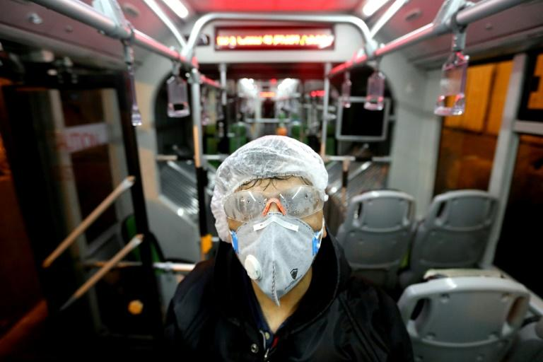 A worker cleans a bus in the Iranian capital Tehran as part of efforts to prevent the spread of coronavirus