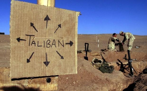 In this photo, taken in 2001, a cardboard sign reminds U.S. marines that the Taliban are everywhere in Afghanistan. It's increasingly true in 2021. (Jim Hollander/Reuters - image credit)