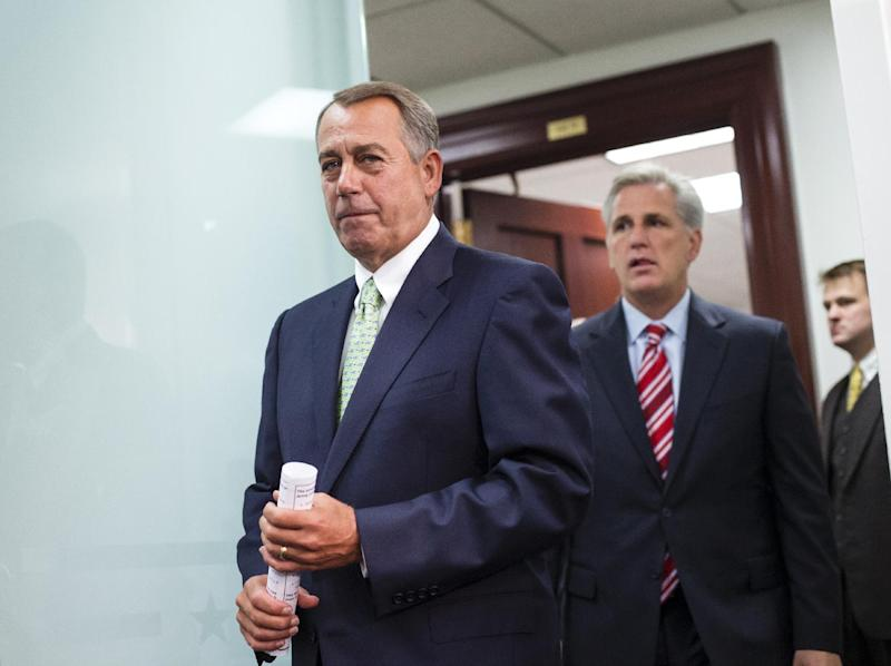 Speaker of the House John Boehner, R-Ohio, and House Republican leaders emerge from a closed-door strategy session at the Capitol, Wednesday, Sept. 18, 2013. House GOP leaders are looking to reverse course and agree to tea party demands to try to use a vote this week on a must-pass temporary government funding bill to block implementation of President Barack Obama's health care law. Boehner is followed by House Majority Whip Kevin McCarthy, R-Calif. (AP Photo/J. Scott Applewhite)