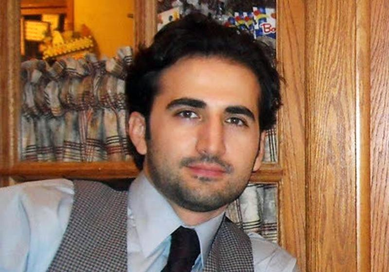 FILE - This undated file photo released by his family via FreeAmir.org shows Amir Hekmati. Hekmati, a former U.S. Marine being held in Iran over the past two years on accusations of spying for the CIA. The semiofficial ISNA news agency reported Saturday, April 12, 2014 that an appeals court has overturned a death sentence of an American man convicted of working for the CIA, instead sentencing him to 10 years in prison. Iran charged Hekmati with receiving special training and serving at U.S. military bases in Iraq and Afghanistan before heading to Iran for his alleged mission. Hekmati's father, a professor at a community college in Flint, Michigan, has said his son is not a CIA spy. (AP Photo/Hekmati family via FreeAmir.org, File)