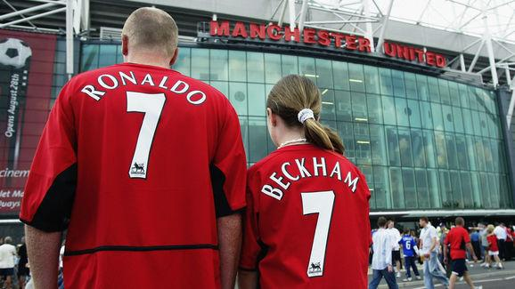 Manchester United fans wearing new boy Cristiano Ronaldo and recently departed David Beckham shirts