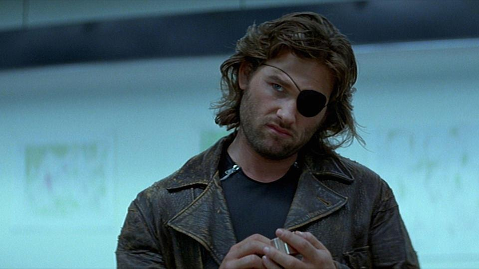 <p> In John Carpenter's Escape from New York, 1997 Manhattan has been transformed into a maximum security prison, and our criminal/ex-soldier antihero Snake Plissken (Kurt Russell) is sent on a mission to rescue the president. Yes, it's as cheesy as it sounds. One of the most iconic B-movies of all time, Escape from New York's an action flick dripping with cool and great hair that more than deserves its cult status. </p>