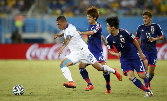 (L-R) Greece's Jose Holebas runs for the ball ahead of Japan's Yuya Osako, Atsuto Uchida and Yoshito Okubo during their 2014 World Cup Group C soccer match at the Dunas arena in Natal June 19, 2014. REUTERS/Toru Hanai (BRAZIL - Tags: SOCCER SPORT WORLD CUP TPX IMAGES OF THE DAY)
