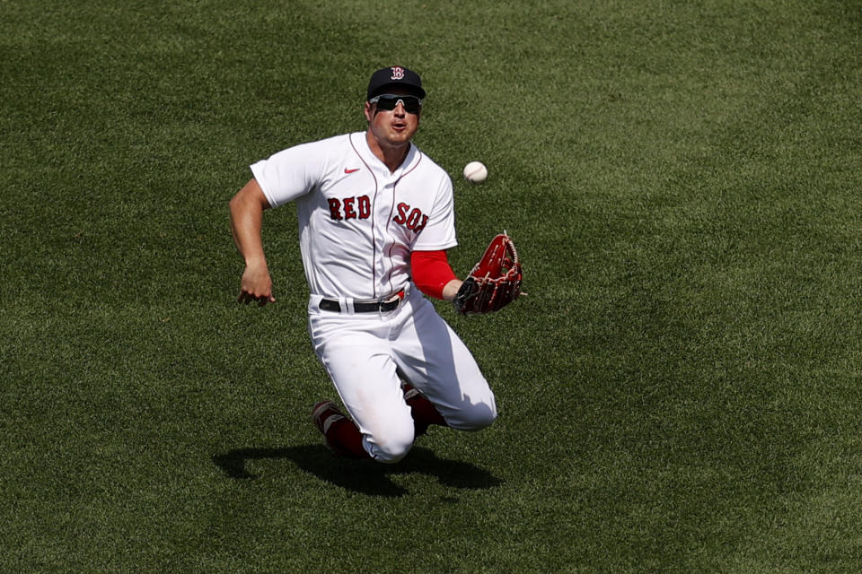 BOSTON, MASSACHUSETTS - JUNE 27: Hunter Renfroe #10 of the Boston Red Sox rolls after catching a fly ball hit by Giancarlo Stanton #27 of the New York Yankees during the sixth inning at Fenway Park on June 27, 2021 in Boston, Massachusetts. (Photo by Maddie Meyer/Getty Images)