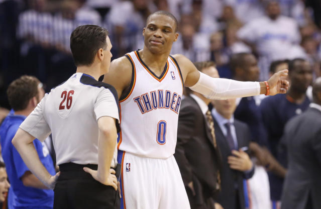 Oklahoma City Thunder guard Russell Westbrook (0) talks with official Pat Fraher (26) in the fourth quarter of Game 2 of the Western Conference semifinal NBA basketball playoff series against the Los Angeles Clippers in Oklahoma City, Wednesday, May 7, 2014. Oklahoma City won 112-101. (AP Photo/Sue Ogrocki)
