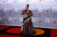 Lizzo arrived on the red carpet wearing a full-length custom Moschino dress with the Hershey's branding emblazoned on the front. The Cuz I Love You singer even had a chocolate clutch bag. (Getty Images)