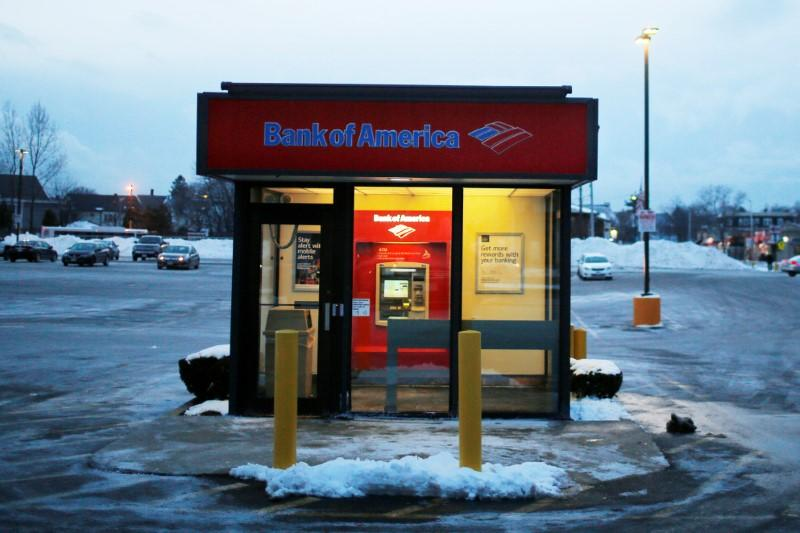 A Bank of America ATM kiosk sits in a parking lot in Medford