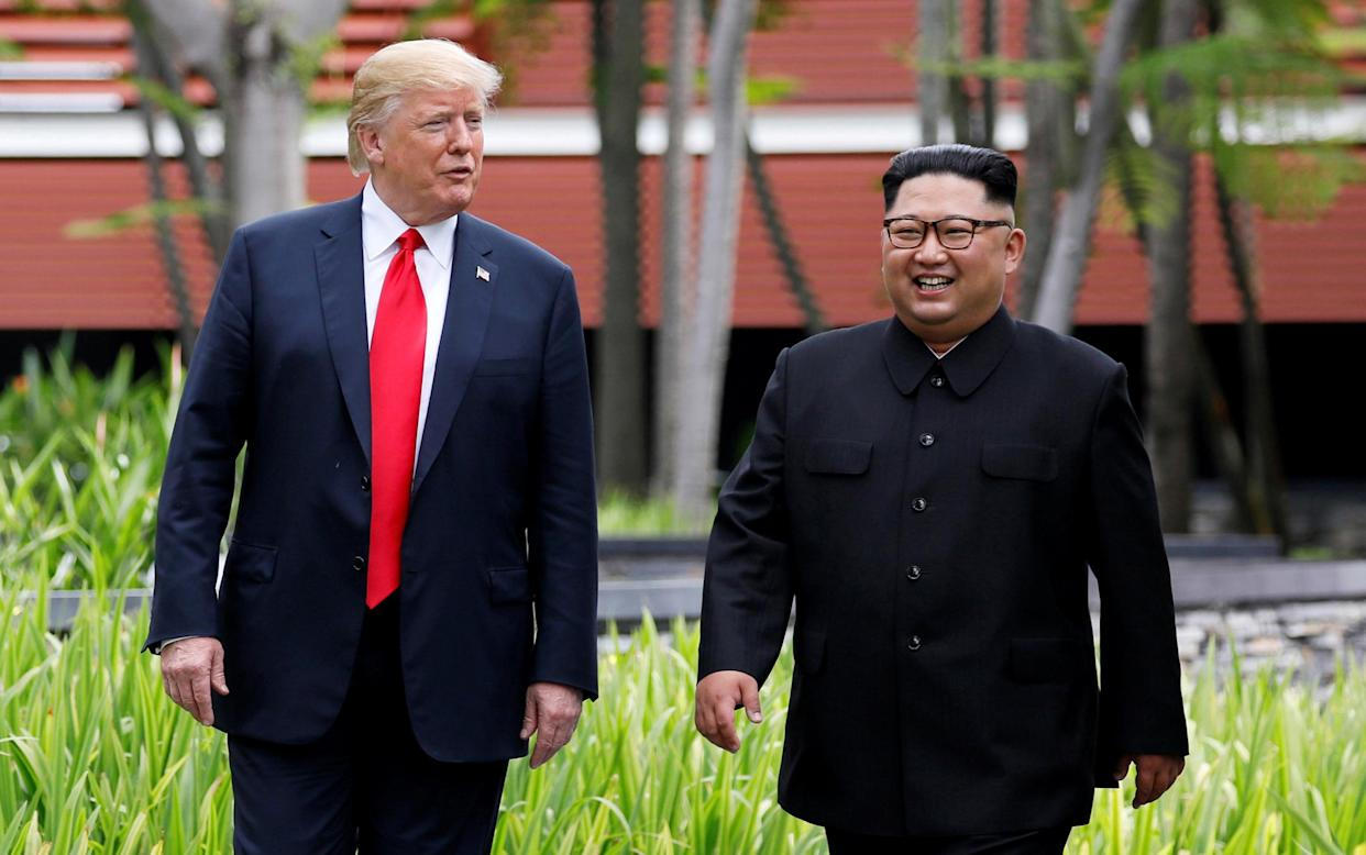 President Trump and North Korean leader Kim Jong Un walk after lunch at the Capella Hotel on Sentosa island in Singapore on Tuesday. (Photo: Jonathan Ernst/Reuters)