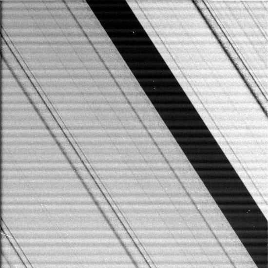 JULY 1 - IN SPACE: This NASA handout photo taken by the Cassini spacecraft on July 1, 2004 shows a portion of Saturn's rings up close. Cassini is the first spacecraft to enter orbit around the ringed planet. It will spend four years gathering information on the planet and its rings and moons. (Photo by NASA/JPL/Space Science Institute via Getty Images)