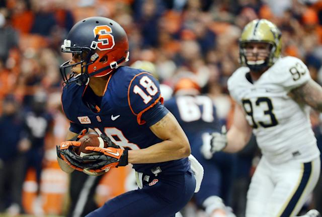 Syracuse's Christopher Clark carries the ball against Pittsburgh during an NCAA college football game at the Carrier Dome in Syracuse, N.Y., Saturday, Nov. 23, 2013. Pittsburgh 17-16. (AP Photo/Heather Ainsworth)