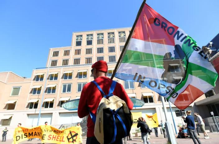 Protester holds a flag during a demonstration outside of the Shell headquarters, in The Hague