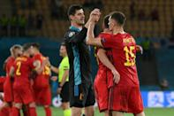 Belgium players celebrate after beating Portugal to set up a Euro 2020 quarter-final against Italy