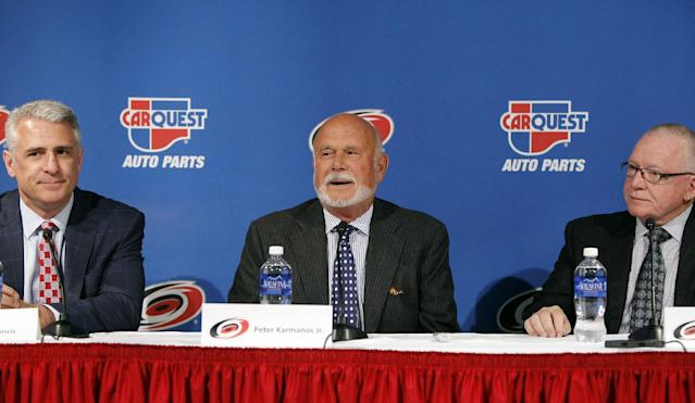New Carolina Hurricanes general manager, Ron Francis, left, team owner Peter Karmanos, center, and former general manager Jim Rutherford announce a management change in Raleigh, N.C., Monday, April 28, 2014. Rutherford stepped down as general manager of the Hurricanes on Monday, and the team promoted Hall of Fame player Francis to replace him. (AP Photo/The News & Observer, Chris Seward)