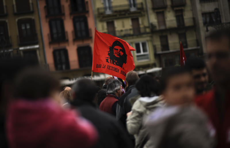 A flag with the face of Che Guevara reading, ''To the Victory. Always'', waves during the celebration of the day of workers, May Day, in Pamplona, northern Spain on Wednesday, May 1, 2013. (AP Photo/Alvaro Barrientos)
