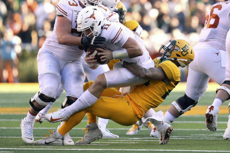 Texas quarterback Sam Ehlinger (11) is sacked by Baylor linebacker Terrel Bernard (26) in the first half of an NCAA college football game Saturday, Nov. 23, 2019, in Waco, Texas. (AP Photo/Richard W. Rodriguez)