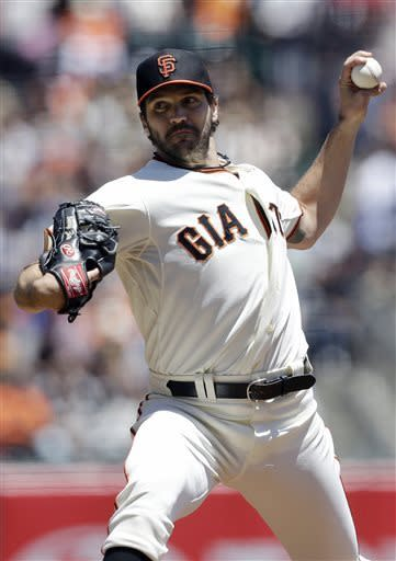 San Francisco Giants pitcher Barry Zito throws against the Oakland Athletics during the second inning of a baseball game in San Francisco, Thursday, May 30, 2013. (AP Photo/Jeff Chiu)