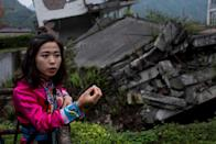 Guides shepherd tourists around the ruins of their destroyed town in the hope of explaining the tragedy of a natural disaster that left tens of thousands of people dead