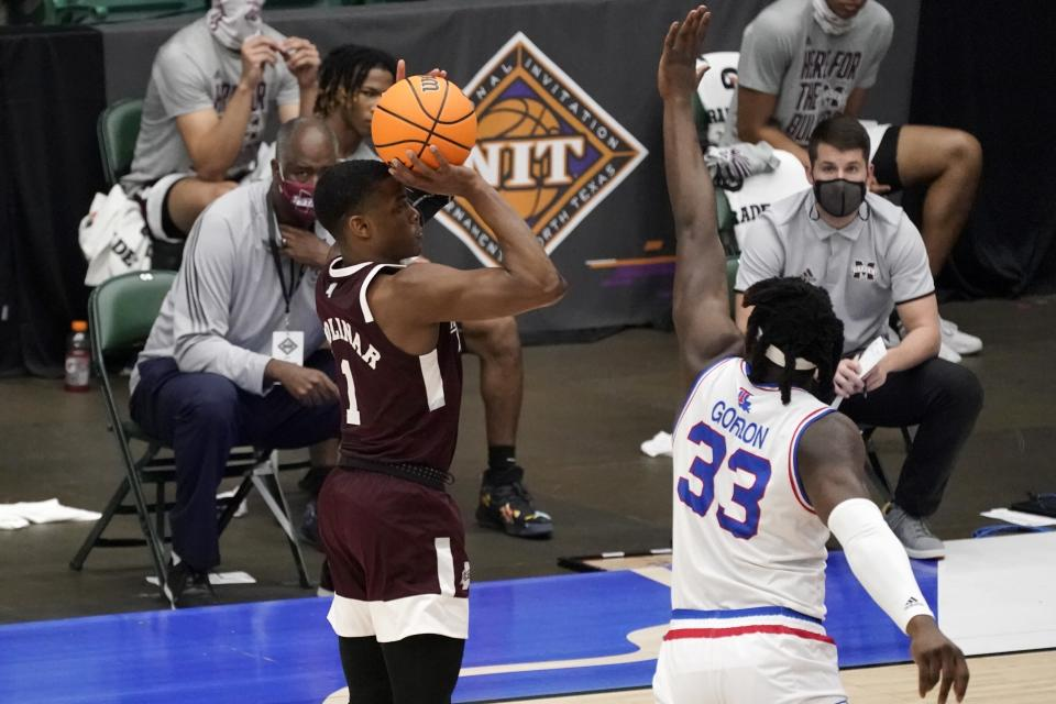 Mississippi State guard Iverson Molinar (1) shoots and sinks a 3-point basket as Louisiana Tech forward Andrew Gordon (33) defends in the second half of an NCAA college basketball game in the semifinals of the NIT, Saturday, March 27, 2021, in Frisco, Texas. (AP Photo/Tony Gutierrez)