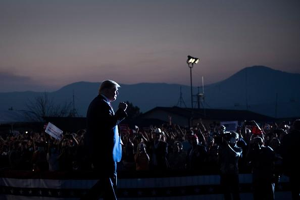 US President Donald Trump arrives to speak at a campaign rally at the Minden-Tahoe airport in Minden, Nevada.