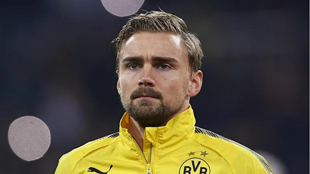 """The left-back was surprisingly left out of the squad for Saturday's 4-0 rout of Bayer Leverkusen as the coach wanted more """"robustness"""" in the position"""