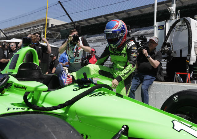 IndyCar driver Danica Patrick climbs into her car to test drive at Indianapolis Motor Speedway in Indianapolis, Tuesday, May 1, 2018. (AP Photo/Michael Conroy)