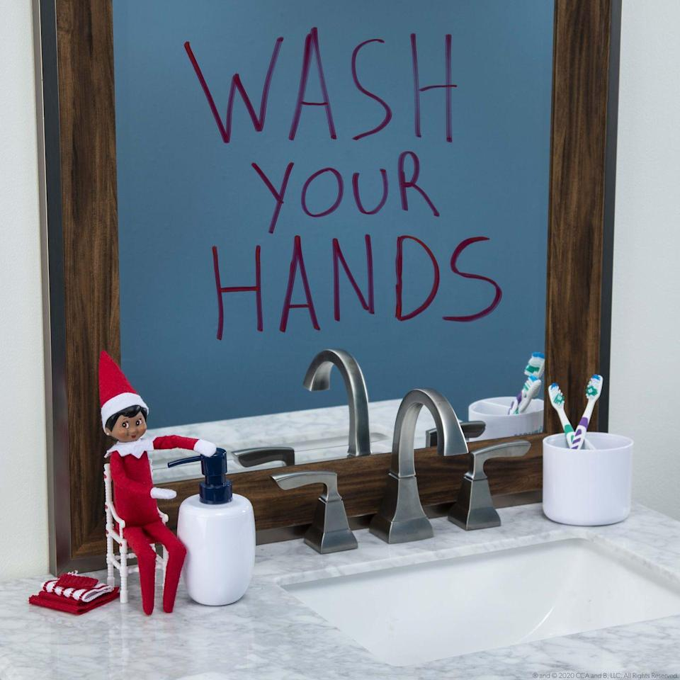 """<p>Hygiene first, even for Elves! Use a dry-erase marker to write this helpful reminder (or any message!) on the bathroom mirror.</p><p><strong>Get the tutorial at <a href=""""https://www.elfontheshelf.com/ideas-scout-elves"""" rel=""""nofollow noopener"""" target=""""_blank"""" data-ylk=""""slk:The Elf on the Shelf"""" class=""""link rapid-noclick-resp"""">The Elf on the Shelf</a>.</strong></p><p><a class=""""link rapid-noclick-resp"""" href=""""https://www.amazon.com/Expo-80174-Designed-Whiteboards-Non-Porous/dp/B000N35G94/ref=sr_1_6?tag=syn-yahoo-20&ascsubtag=%5Bartid%7C10050.g.22690552%5Bsrc%7Cyahoo-us"""" rel=""""nofollow noopener"""" target=""""_blank"""" data-ylk=""""slk:Shop Dry-Erase Markers"""">Shop Dry-Erase Markers</a></p>"""
