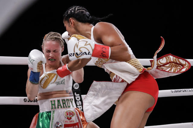 Amanda Serrano, right, punches Heather Hardy during the first round of a featherweight boxing match Friday, Sept. 13, 2019, in New York. Serrano won the fight. (AP Photo/Frank Franklin II)