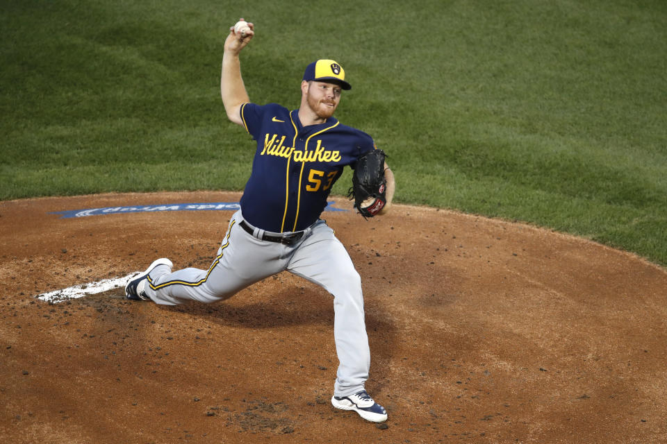 Milwaukee Brewers starting pitcher Brandon Woodruff throws during the first inning of a baseball game against the Chicago Cubs, Friday, Aug. 14, 2020, in Chicago. (AP Photo/Jeff Haynes)