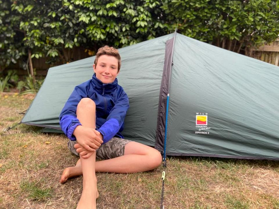 Max Woosey, aged 11, camping out in his tent in his garden in Braunton, Devon. (SWNS)