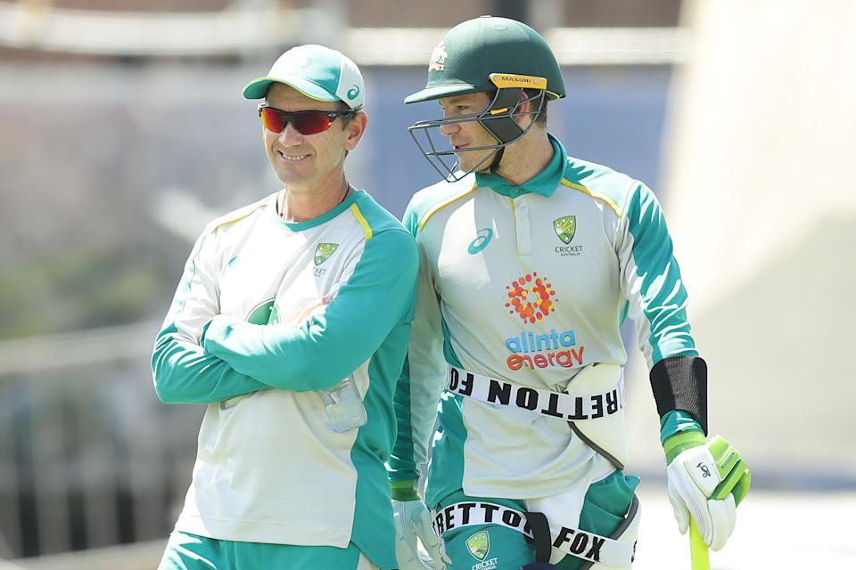 Tim Paine (pictured right) shares a laugh with coach Justin Langer (pictured left) during training.
