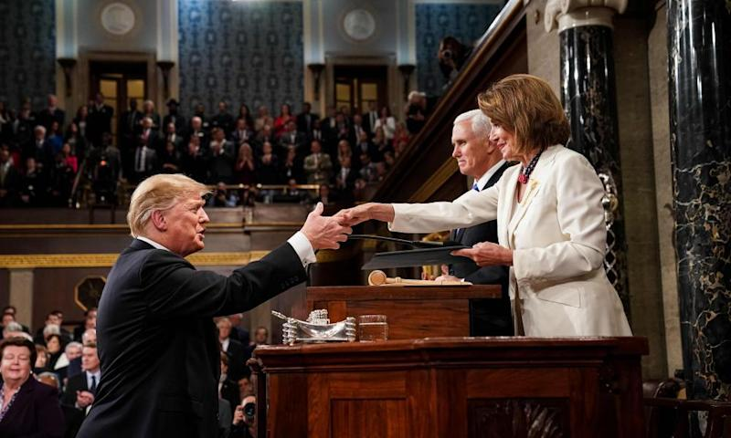 Trump greets the House speaker, Nancy Pelosi, as he arrives to deliver the State of the Union address.
