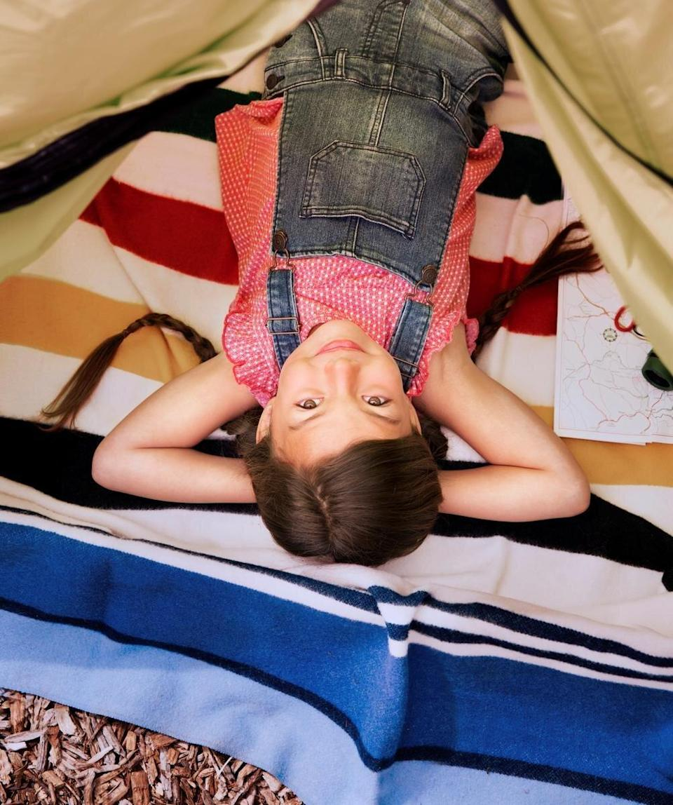 Camping Destinations Girl Laying Down Inside A Tent
