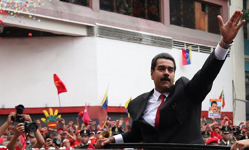 President-elect Nicolas Maduro waves to supporters as he arrives to the Venezuelan Parliament for his swearing-in ceremony in Caracas, Venezuela, Friday, April 19, 2013. The opposition boycotted the ceremony, hoping that the ruling party's last-minute decision to allow an audit of nearly half the vote could change the result in a the bitterly disputed presidential election.(AP Photo/Gil Montano)