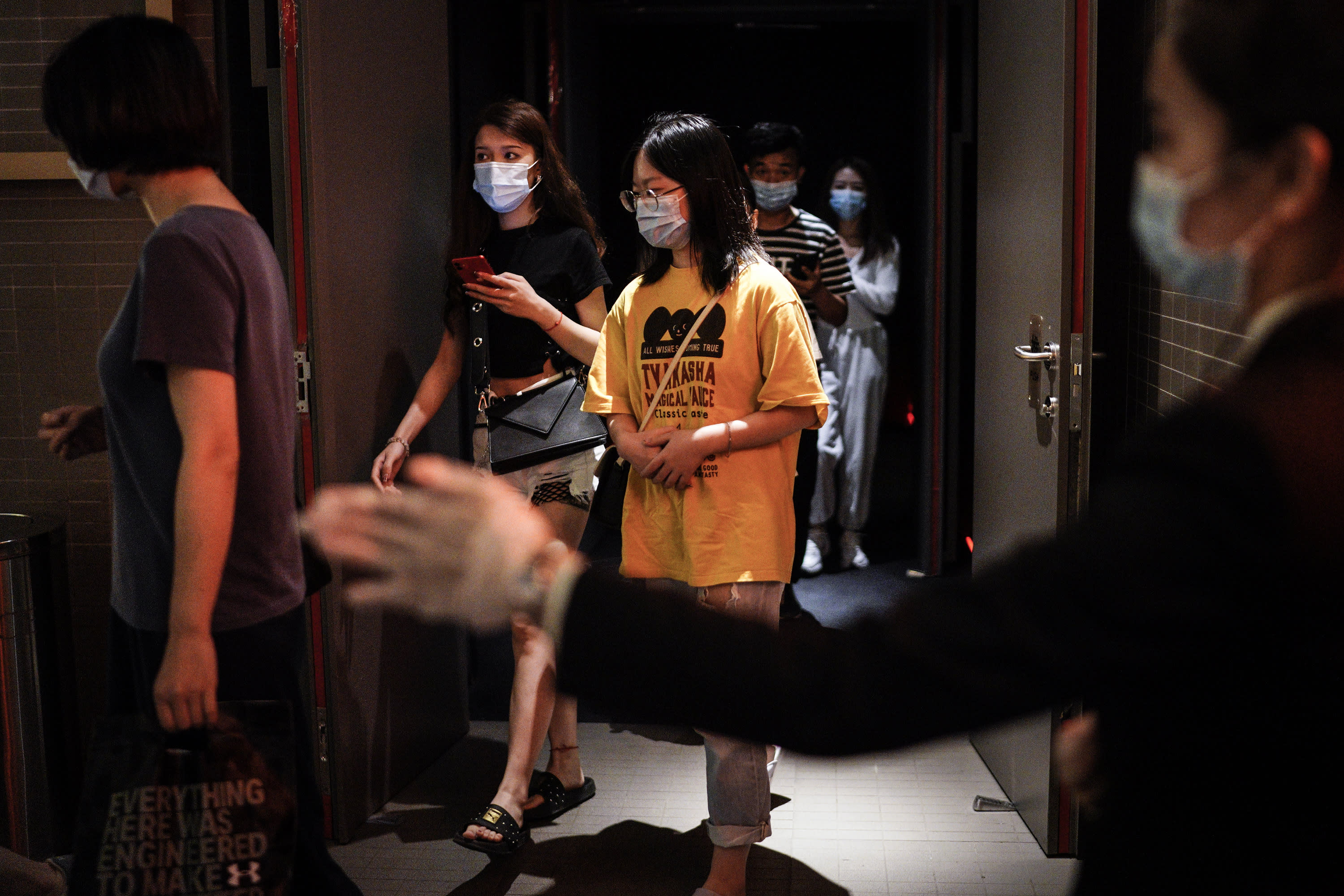 WUHAN, CHINA - JULY 20: (CHINA OUT)The employee wear the protective a mask while guides the audience through a passage to the exit in a cinema at Wuhan on July 20, 2020 in Wuhan ,Hubei Province,China.Taking various measures against COVID-19, cinemas in the city reopened in an orderly manner on Monday. The China Film Administration, in a circular last week, allowed cinemas in low-risk areas to resume operation with effective epidemic prevention measures in place. (Photo by Getty Images)