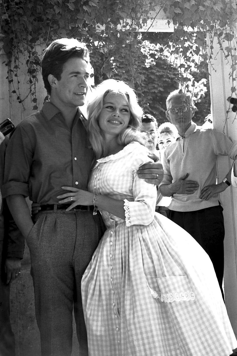 <p>Brigitte Bardot and her <em>Babette Goes to War</em> costar, Jacques Charrier, were married in a registry office in Louveciennes, France. The bride wore a simple, yet chic, pink gingham shirt dress for the ceremony.</p>