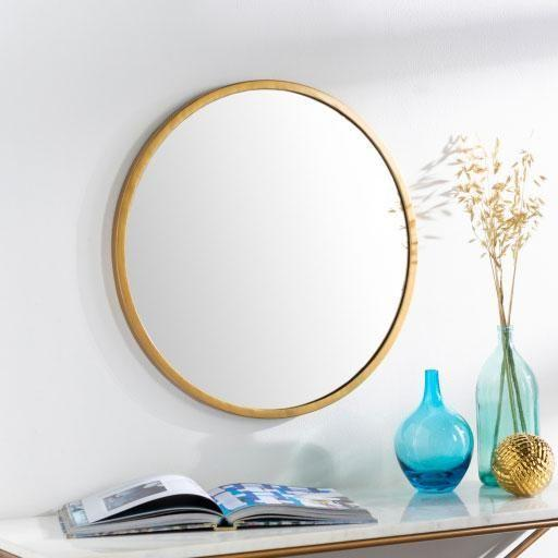 """<p><strong>Jungalow</strong></p><p>jungalow.com</p><p><strong>$159.00</strong></p><p><a href=""""https://www.jungalow.com/collections/wall-decor/products/round-gold-mirror"""" rel=""""nofollow noopener"""" target=""""_blank"""" data-ylk=""""slk:Shop Now"""" class=""""link rapid-noclick-resp"""">Shop Now</a></p><p>You may not like vanities with attached mirrors, and that's okay! Here's a sleek and simple mirror that you can hang over the vanity of your dreams.</p>"""