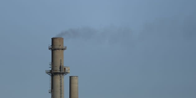 Emissions are seen coming from an Ontario cement plant in this 2015 file photo. Experts say the provincial government's plan to repeal a toxic substance regulation with affect human health and the environment.