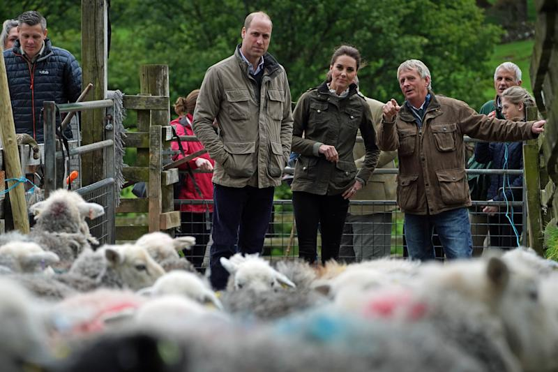 RETRANSMISSION ADDING NAMES The Duke and Duchess of Cambridge with Chris Brown (right) during a visit to Deepdale Hall Farm, a traditional fell sheep farm, in Patterdale, Cumbria.