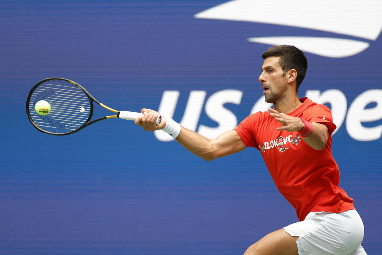 NEW YORK, NEW YORK - AUGUST 28: Novak Djokovic of Serbia returns the ball during a practice session prior to the start of the 2021 US Open at USTA Billie Jean King National Tennis Center on August 28, 2021 in the Queens borough of New York City. (Photo by Sarah Stier/Getty Images)