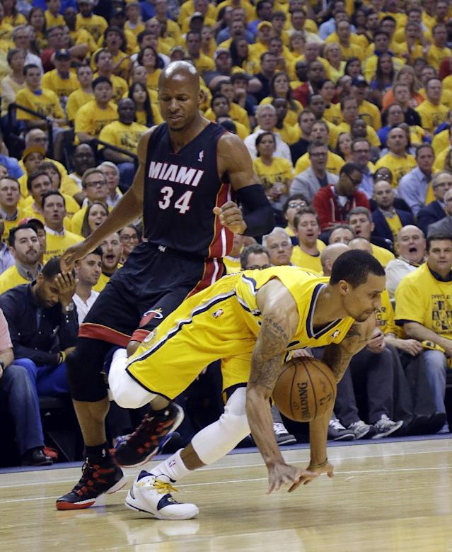 Indiana Pacers' George Hill comes up with a loose ball against Miami Heat's Ray Allen (34) during the first half of Game 2 of the NBA basketball Eastern Conference finals in Indianapolis, Tuesday, May 20, 2014. (AP Photo/Michael Conroy)