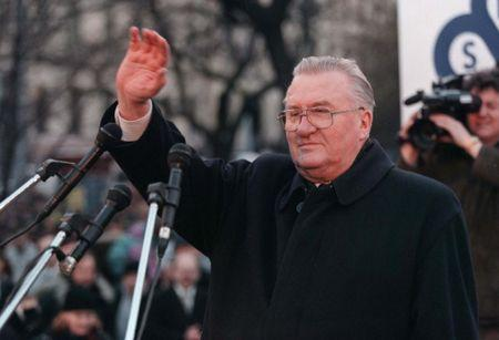 Former Slovak President Michal Kovac waves to anti-government demonstrators protesting against the policies of Slovak Prime Minister Vladimir Meciar in Bratislava