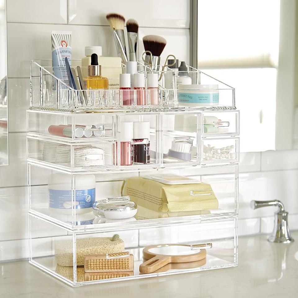 "<h3>Large Luxe Acrylic Makeup Organizer Clear<br></h3><br><strong>The Modular Makeup Organizer</strong><br><br>If you love perusing Pinterest for #organizationporn, then this choose-your-own-adventure modular organizer is perfect for expanding your storage setup as needed.<strong><br></strong><br><strong>The Hype: </strong>4.5 out of 5 stars and 127 reviews on <a href=""https://fave.co/3aQiXiC"" rel=""nofollow noopener"" target=""_blank"" data-ylk=""slk:The Container Store"" class=""link rapid-noclick-resp"">The Container Store</a><br><br><strong>Organization Obsessives Say: </strong>""I was contemplating on several different options for my make up storage, and then ran upon these items in The Container Store. I will have to say that I absolutely love it! The pieces are easily stack-able - without moving or sliding around. Also, it gives me the ability to add the unit as I grow my makeup collection. This system is awesome and I would recommend to anyone!"" — MakeupMommy, The Container Store Reviewer<br><br><strong>The Container Store</strong> Large Luxe Acrylic Makeup Organizer Clear, $, available at <a href=""https://go.skimresources.com/?id=30283X879131&url=https%3A%2F%2Ffave.co%2F3aQiXiC"" rel=""nofollow noopener"" target=""_blank"" data-ylk=""slk:The Container Store"" class=""link rapid-noclick-resp"">The Container Store</a>"