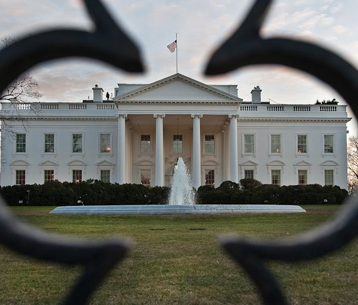 The White House is seen thru the front wrought iron fence near sunset March 5, 2010, in Washington (AFP Photo/Paul J. Richards)